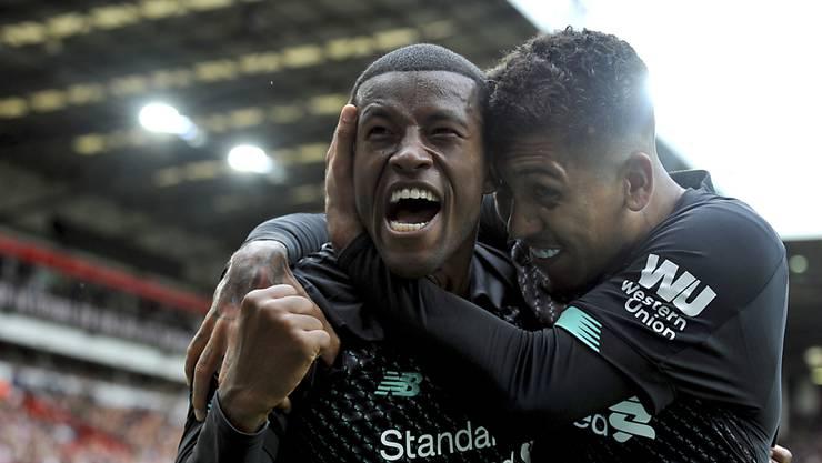 Roberto Firmino und Torschütze Georginio Wijnaldum (links) freuen sich über Liverpools siebten Sieg in Folge