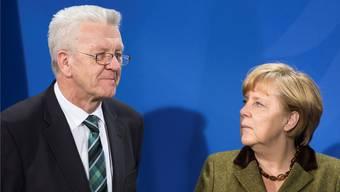 Winfried Kretschmann und Angela Merkel: Sie loben sich gegenseitig. Getty Images