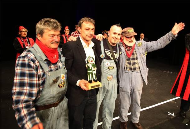 Umzugsprämierung: Die Protagonisten der Guggi-Zunft mit v.l. Toni Zettel; Max Gruber, Beat Nyffeler und Marc Berthoud.