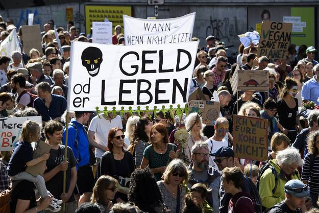 """People demonstrate during a """" National Climate strike """" demonstration to protest a lack of climate awareness in Bern, Switzerland, Saturday, September 28, 2019. (KEYSTONE/Anthony Anex)"""
