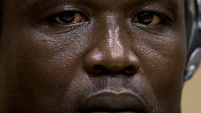Dominic Ongwen, a Ugandan commander in warlord Joseph Kony's feared militia, waits for the start of court procedures as he made his first appearance at the International Criminal Court in The Hague, Netherlands, Monday, Jan. 26, 2015. Ongwen arrived in The Hague last week after being taken into custody in Central African Republic. He faces war crimes and crimes against humanity charges for his alleged role in a reign of terror that has spanned more than 25 years in central Africa's Great Lakes region. (AP Photo/Peter Dejong, Pool)