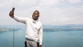 Der Schweizer Sprint-Star Alex Wilson: ein Selfie mit dem Vierwaldstättersee.
