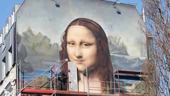 Mona Lisa lächelt neu in Übergrösse in Berlin.
