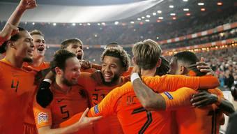 Die Niederländer bejubeln den Sieg über Weltmeister Frankreich