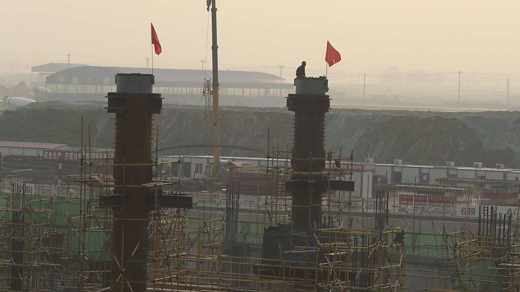 Flughafenbau in Peking: Chinas Immobilienmarkt läuft heiss - und verhilft der Wirtschaft zu Wachstum. (Symbolbild)