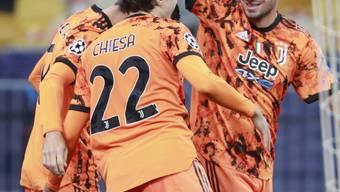 Die Juve-Spieler jubeln in Kiew nach dem ersten Tor von Alvaro Morata (verdeckt)