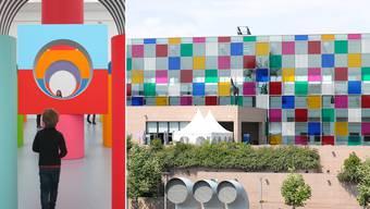 Links: Kunst so farbig und fröhlich wie Bauklötzli. Rechts: Das farbige Würfelmuster der Museumsfassade leuchtet weithin.