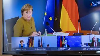 Angela Merkel (CDU), Bundeskanzlerin, spricht bei Beratungen der deutschen Ministerpräsidenten in einer Videokonferenz. Foto: Axel Heimken/dpa
