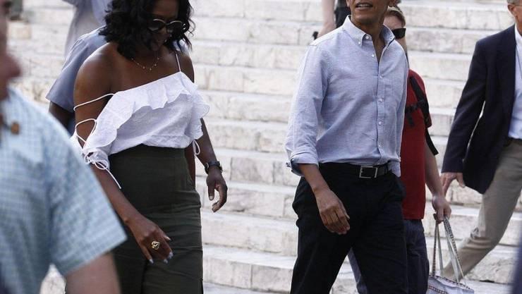 Die Obamas machen viel Ferien: Auf dem Bild flanieren sie Ende Mai durch Siena, nächste Woche geht's ab nach Indonesien. (Archivbild)
