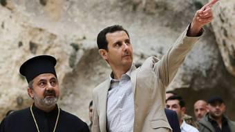Syriens Staatschef Baschar al-Assad (rechts) hofft auf Wiederwahl