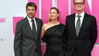 Bridget Jones (M, Renée Zellweger) zwischen den beiden potenziellen Vätern ihres Babys, Jack (l, Patrick Dempsey) und Marc Darcy (r, Colin Firth).
