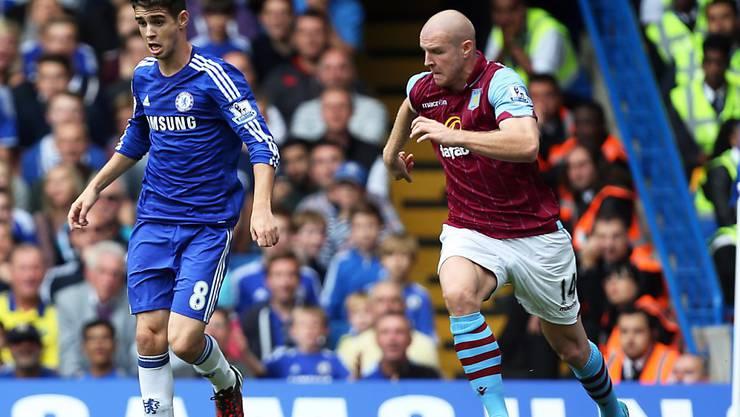 Oscar (links), heute Topverdiener in China, in einem früheren Premier-League-Duell mit Chelsea gegen den Schweizer  Philippe Senderos (damals Aston Villa)