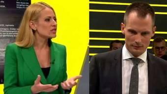 Die Moderatoren Christa Rigozzi und Jonas Projer.