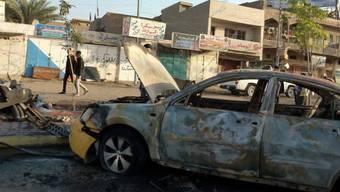 Nach der Explosion einer Autobombe in Bagdad