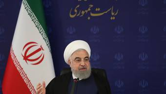 HANDOUT - Hassan Ruhani, Präsident des Iran, äußert sich während einer Sitzung des iranischen Nationalkomitees zur Bekämpfung des Coronavirus. Foto: ---/Iranian Presidency/dpa - ATTENTION: editorial use only and only if the credit mentioned above is referenced in full