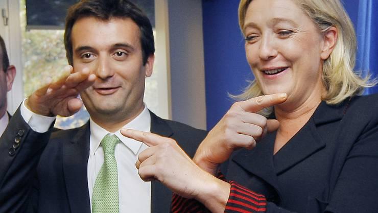 Da war die Fron-National-Welt noch in Ordnung: Florian Philippot witzelt mit Parteichefin Marine Le Pen. (Archiv)