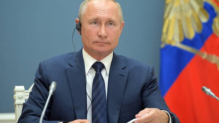 HANDOUT - Die Operation Machterhalt für Kremlchef Wladimir Putin hat erwartungsgemäß ihre letzte Hürde genommen. Foto: Alexei Druzhinin/Pool Sputnik Kremlin/AP/dpa