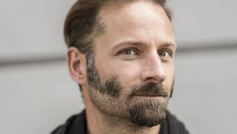 Urs Mannhart gehört mit Daniel Goetsch und Gianna Molinari zu den Schweizer Schriftstellern, die zum Wettlesen 2017 in Klagenfurt eingeladen wurden. (Archivbild)
