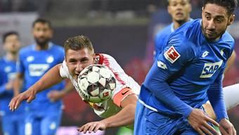 Leipzigs Willi Orban (links) sorgte kurz vor Schluss für den Ausgleichstreffer gegen Hoffenheim