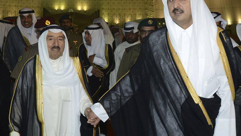 Katars Emir Tamim bin Hamad Al Thani (rechts) muss nach US-Ansicht noch mehr gegen den Terrorismus tun.