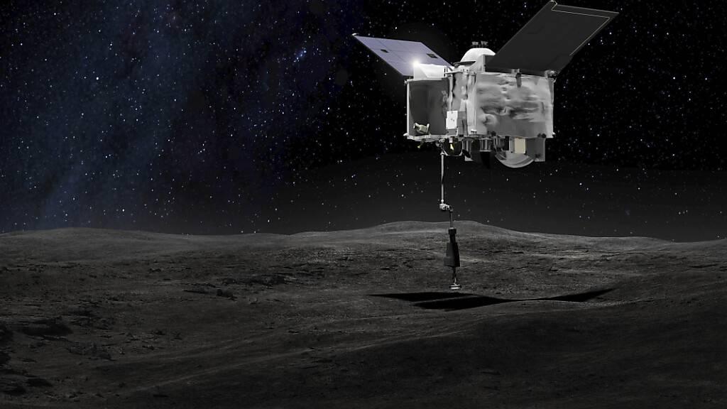 ARCHIV - Diese von der NASA zur Verfügung gestellte Illustration zeigt die Nasa-Sonde «Osiris-Rex» auf dem Asteroiden Bennu. Foto: Uncredited/NASA/Goddard Space Flight Center/AP/dpa - ACHTUNG: Nur zur redaktionellen Verwendung im Zusammenhang mit der aktuellen Berichterstattung und nur mit vollständiger Nennung des vorstehenden Credits