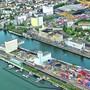 Im Rheinhafen Kleinhüningen hat die Basler Regierung ein Baurecht für eine Parzelle einer Logistikfirma abgekauft.