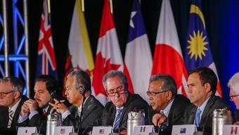 Die Handelsminister des Pazifik-Anrainer sprechen in Atlanta von einem historischen Abkommen. Doch der Vertrag umstritten - und muss noch von den Parlamenten abgesegnet werden.