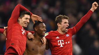Die Bayern jubeln nach dem 4:0 gegen Dortmund.