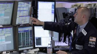 Ein Mitarbeiter an der Börse in New York (Archiv)