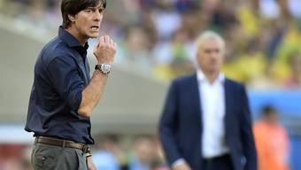 Wer wird im Vordergrund stehen? Wie im Bild Deutschlands Trainer Joachim Löw oder Frankreichs Didier Deschamps?