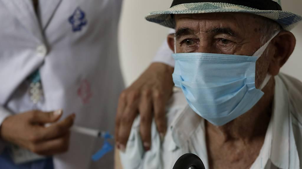 Laut WHO-Regionaldirektor Hans Kluge dürfte die Corona-Pandemie noch rund zehn Monate dauern. (Symbolbild)