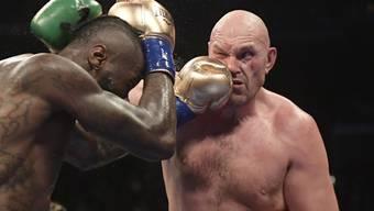Kein Sieger nach 12 WM-Runden: WBC-Titelhalter Deontay Wilder (links) und Tyson Fury (rechts) werden sich wohl nochmals duellieren