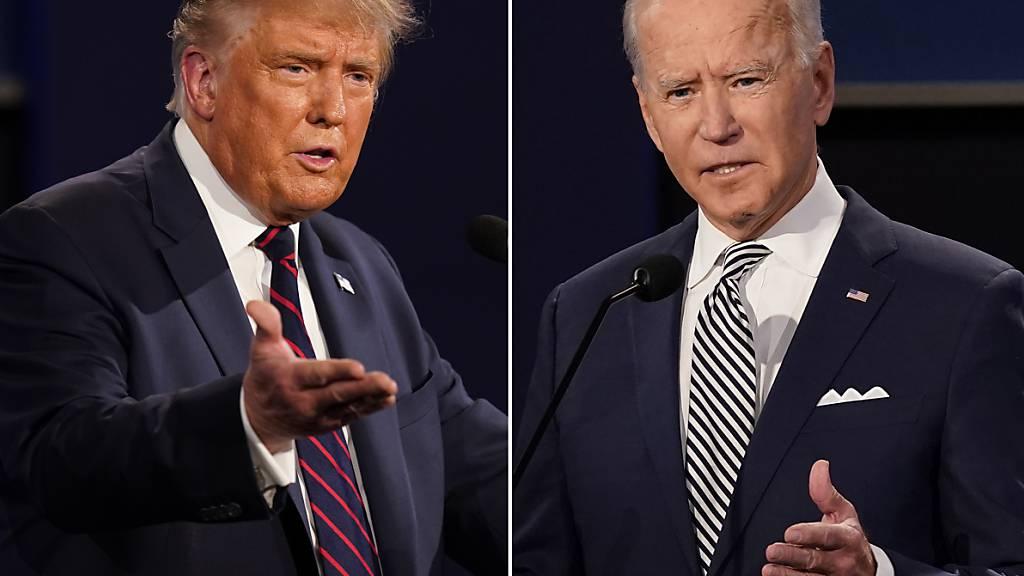 ARCHIV - Die Bildkombo zeigt Präsident Trump (l) und den ehemaligen Vizepräsidenten Joe Biden während der ersten Präsidentschaftsdebatte im September an der Case Western University und der Cleveland Clinic in Cleveland, Ohio. Foto: Patrick Semansky/AP/dpa