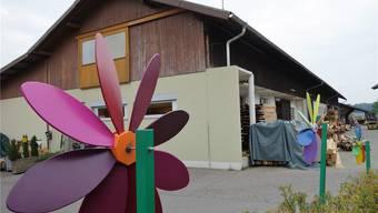 Das Holzlager im Murimoos ist sanierungsbedürftig, das baufällige Gewerbegebäude wird einem Neubau weichen. Eddy Schambron
