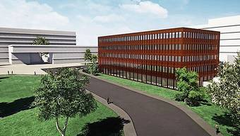 Das neue Gebäude (im Zentrum) wird 2023 in Betrieb genommen.