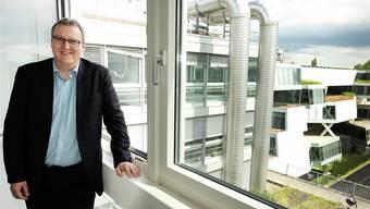 Hoch erfreut über die gute Nachfrage: André Moeri, Projektleiter. Im Hintergrund sind die Actelion-Gebäude sichtbar.