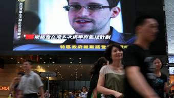 Snowden sorgte in Hongkong noch einmal für Schlagzeilen, bevor er den Flieger nach Moskau bestieg.KEY