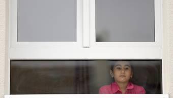 Minderjährige Flüchtlinge werden in den selben Unterkünften wie die Erwachsenen untergebracht (Symbolbild).