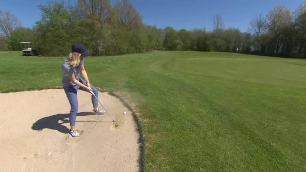 Beim Golfspielen