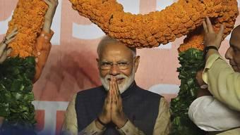 Indiens Premierminister Narendra Modi bekommt mit einem deutlichen Wahlsieg seiner Partei eine zweite Amtszeit.