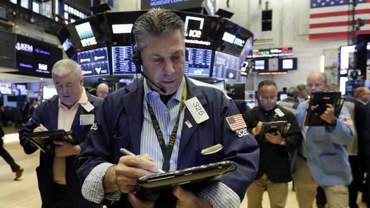 In den USA dominiert der Beruf oftmals das Privatleben. Im Bild: Händler William McInerney an der Wall Street.