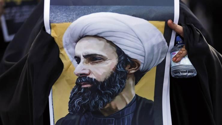 Porträt des hingerichteten schiitischen Geistlichen Nimr al-Nimr bei einer Demonstration in Bahrain.