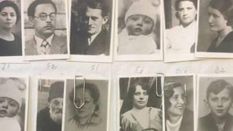 Von der Fremdenpolizei beschlagnahmte Passfotos in einer Schweizer Wohnung. Pässe erhielten die Abgebildeten nicht, den Holocaust haben sie wohl nicht überlebt.