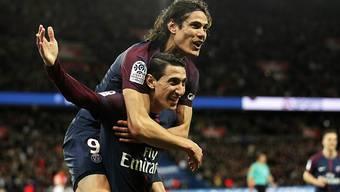 Angel di Maria (unten) und Edinson Cavani feiern den Meistertitel mit Paris Saint-Germain
