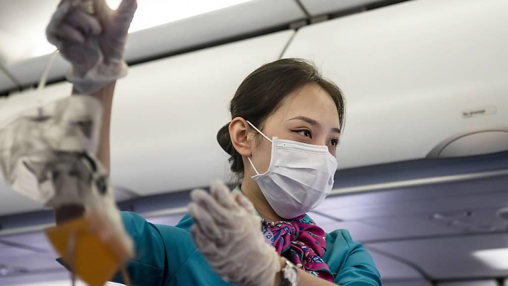 Nicht nur bei asiatischen Airlines, auch bei der Swiss sollen Masken schon bald zum Alltag gehören.
