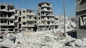 Nach monatelangem Beschuss sind Teile von Homs stark zerstört