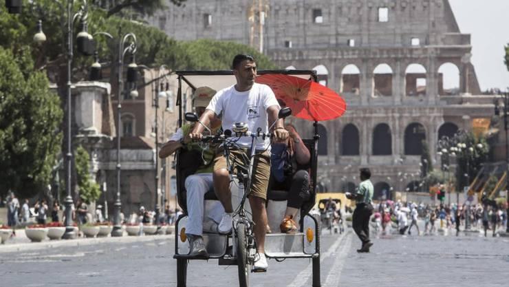 Rastlos in Rom: Das Geschäft mit Touristen in Italien brummt in diesem Sommer.