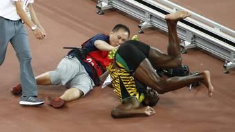 Gewinnt Gold und wird kurz darauf von einem Kameramann überfahren: Usain Bolt im August 2015.