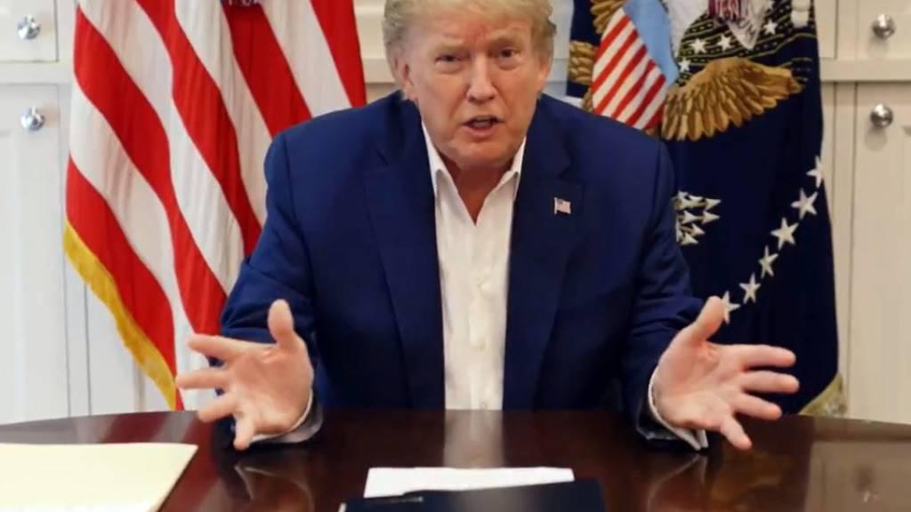 HANDOUT - Das Standbild aus einem Twitter-Video zeigt den US-Präsidenten Donald Trump. Foto: Donald J. Trump/TWITTERvia AAP/dpa - ACHTUNG: Nur zur redaktionellen Verwendung im Zusammenhang mit der aktuellen Berichterstattung und nur mit vollständiger Nennung des vorstehenden Credits