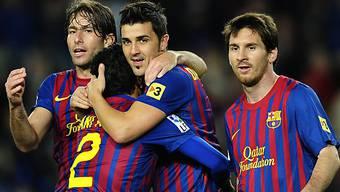 David Villa (m.) markierte das 4:0 für Barcelona